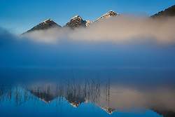 Small lake in early morning fog near border to Chile, Nahuel Huapi National Park,Argentina,South America
