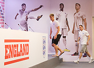 Joe Hart of England and Wayne Rooney of England walk into the England press conference at Est&aacute;dio Claudio Coutinho, Rio de Janeiro<br /> Picture by Andrew Tobin/Focus Images Ltd +44 7710 761829<br /> 21/06/2014