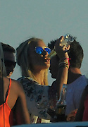 EXCLUSIVE - FEE £500 all round if used - web fees to be arranged<br /> <br /> Steven Gerrad, English footballer, captain of Liverpool and England National Team, with his wife fashion journalist Alex Curran<br /> have fun at a sunset party  in Izzy's bar at Ancão beach, near Quinta do Lago. While recovering from surgery on his shoulder Gerrad drank draft beer as well as Alex who preferred the bottled beer Corona. <br /> Algarve, Portugal, they where also joined by Harry Kewell<br /> ©Exclusivepix