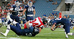 09.07.2011, UPC Arena, Graz, AUT, American Football WM 2011, Group B, Frankreich (FRA) vs Kanada (CAN), im Bild Nick FitzGibbon (Canada, #34, RB) beeing stopped by the french defense line// during the American Football World Championship 2011 Group B game, France vs Canada, at UPC Arena, Graz, 2011-07-09, EXPA Pictures © 2011, PhotoCredit: EXPA/ E. Scheriau