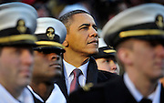 President Barack Obama looks on game action as he visits with U.S. Navy Midshipmen as he attends the U.S. Army vs. U.S. Navy college football game at FedEx Field in Landover, Md., Saturday, December 10, 2011. (DOD PHOTO BY GLENN FAWCETT)(Released)