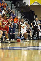 20 March 2010: Philana Greene controls the ball at the Bears end and heads for her own hoop. The Flying Dutch of Hope College fall to the Bears of Washington University 65-59 in the Championship Game of the Division 3 Women's NCAA Basketball Championship the at the Shirk Center at Illinois Wesleyan in Bloomington Illinois.