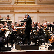 """March 27, 2012 - New York, NY : Music Director and Conductor Michael Tilson Thomas, on podium, leads the San Francisco Symphony in Edgard Varèse's """"Amériques"""" in Carnegie Hall's Stern Auditorium on Tuesday evening.  CREDIT : Karsten Moran for The New York Times"""