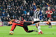 Joshua King (17) of AFC Bournemouth falls over after being challnged by Claudio Yacob (5) of West Bromwich Albion during the Premier League match between Bournemouth and West Bromwich Albion at the Vitality Stadium, Bournemouth, England on 17 March 2018. Picture by Graham Hunt.