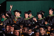 Ohio University students cheer on their fellow classmates as they are awarded their degrees during the Commencement ceremony Friday May 2, 2014.  Photo by Ohio University / Jonathan Adams