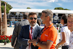 Santiago Varela (ESP) the course builder talking to Eric Van der Vleuten<br /> Furusiyya FEI Nations Cup Jumping Final <br /> CSIO Barcelona 2013<br /> © Dirk Caremans