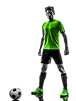 one soccer football player young man standing defiance in silhouette studio on white background