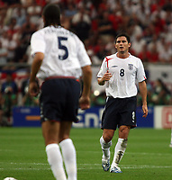 Photo: Chris Ratcliffe.<br /> England v Portugal. Quarter Finals, FIFA World Cup 2006. 01/07/2006.<br /> Rio Ferdinand and Frank Lampard of England.