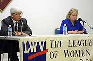 LANGHORNE, PA - OCTOBER 16: State Sen. Tommy Tomlinson (L), R-6 answers a question posed by moderator Tam St. Claire (not shown) as challenger Northampton Democrat Kimberly Rose (R) listens during a debate at Attleboro Retirement Community October 16, 2014 in Langhorne, Pennsylvania. (Photo by William Thomas Cain/Cain Images)