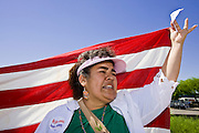 "01 MAY 2006 - PHOENIX, AZ: MARIA VAZQUEZ and about 1000 other immigrants gathered on a street corner in Phoenix at a Home Depot store during a protest in favor of immigration reform during the ""Day without Immigrants"" protest in Phoenix. About 1,000 people picketed the corner, which had been a popular gathering spot for day laborers until Home Depot took action to keep day laborers off their property. Immigrants rights groups picketed two Home Depot stores, a pallet manufacturing plant and a public school during the protest. Photo by Jack Kurtz"