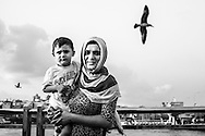 A woman poses with her child near Galata bridge in Istanbul.