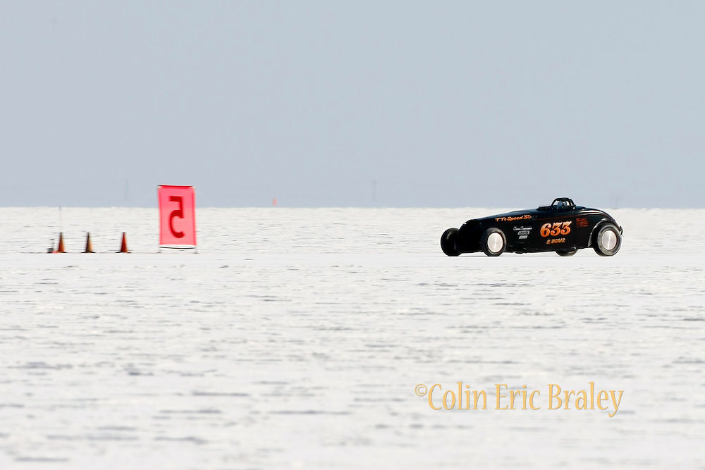 Best cars-people-atmosphere-photos of 2009 Bonneville Speed Week- Tom Tait, owner and driver of TT's Speed 33 from Phoenix, AZ. makes a run at the Bonneville Speed Way. August 9, 2009.  Photo by Colin E. Braley