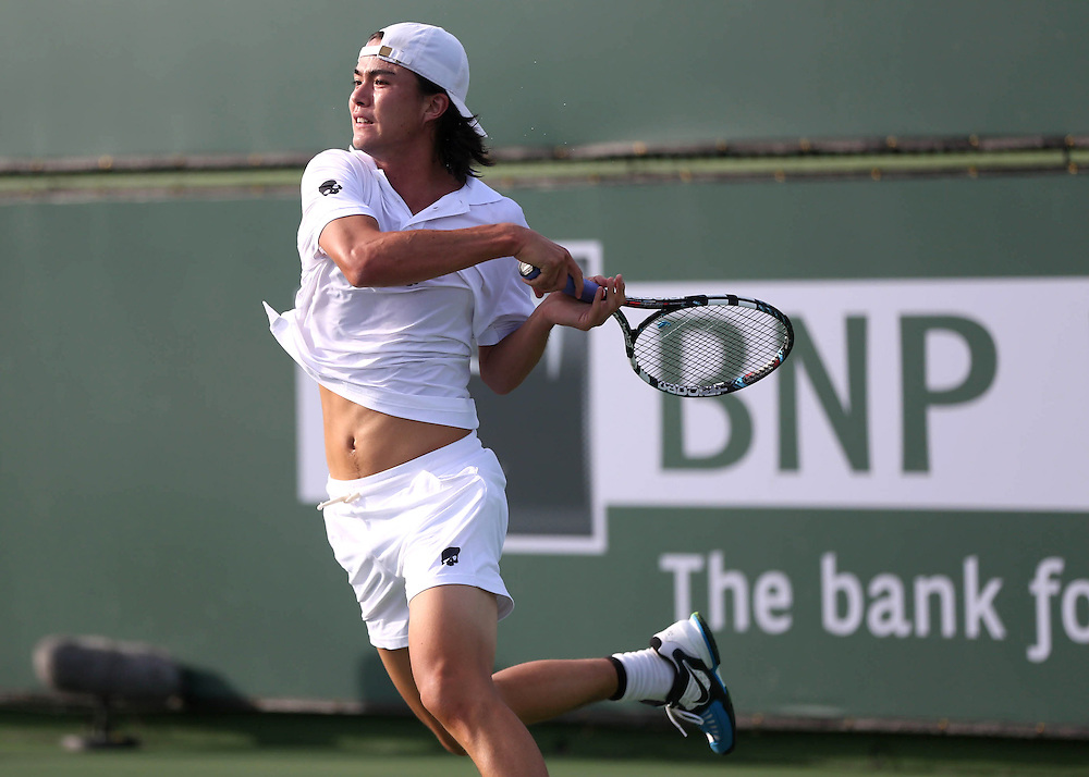 March 5, 2014, Indian Wells, California: Taro Daniel hits a forehand during a match against Alex Kuznetsov.<br /> (Photo by Billie Weiss/BNP Paribas Open)