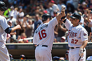 Josh Willingham #16 and Chris Parmelee #27 of the Minnesota Twins celebrate after Willngham hit a home run against the Seattle Mariners on June 2, 2013 at Target Field in Minneapolis, Minnesota.  The Twins defeated the Mariners 10 to 0.  Photo: Ben Krause
