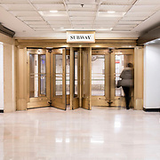 March 14, 2018 - New York, NY : The century-old Equitable Building, whose construction atop an entire city block at 120 Broadway in Lower Manhattan inspired the establishment of zoning regulations, has been undergoing a series of changes including the recent creation of a public hearing room for the Department of City Planning. Further renovation by the building's owner, Silverstein Properties, to be carried out by the architecture firm Beyer Blinder Belle and the landscape architecture firm MPFP, are also underway. Here, revolving doors in the lower level concourse lead to the subway.  CREDIT: Karsten Moran for The New York Times