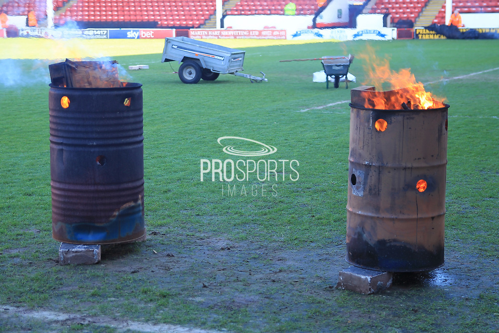 Braziers on the pitch - fire - defrost the pitch during the EFL Sky Bet League 1 match between Walsall and Rochdale at the Banks's Stadium, Walsall, England on 2 February 2019.