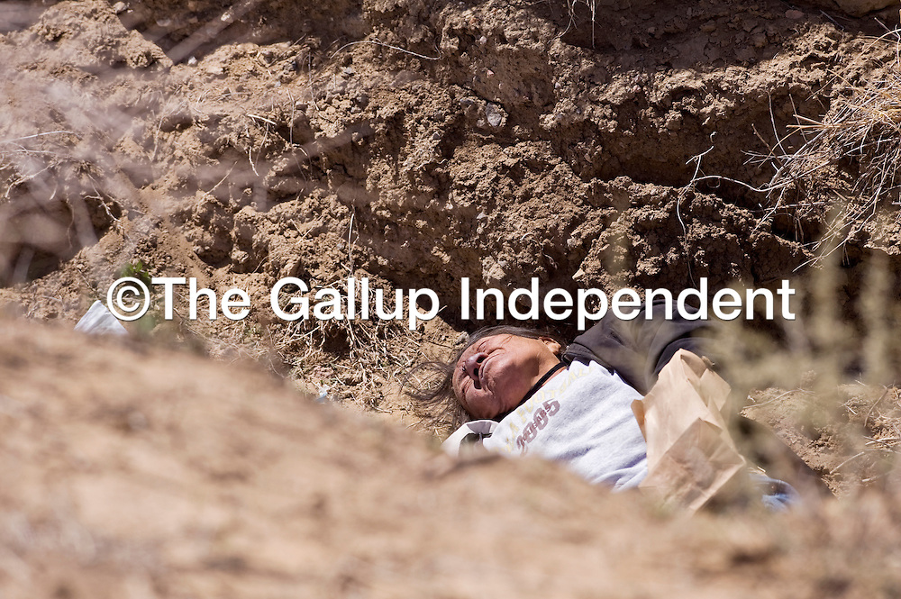 041813       Cable Hoover<br /> <br /> Gallup Police are still working to identify the body of a woman that was found in a ditch on Gallup's north side Thursday. Police said that her death was likely caused by exposure.