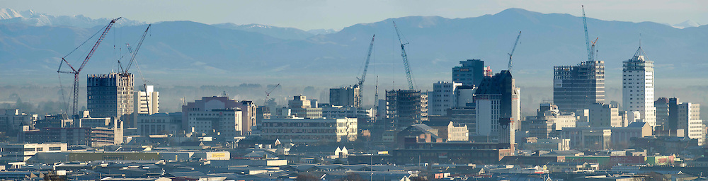 A diminishing skyline dotted with cranes against a light smog as work continues on demolishing earth quake damaged high rise buildings in the Christchurch CBD,  New Zealand,  Wednesday, July 11, 2012. Credit:  SNPA / David Alexander.