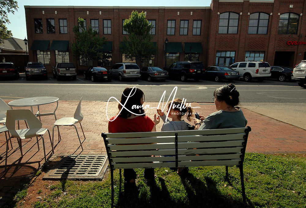 11/21/09 (lft-rt) Lana Bodach-Turner and her children, Caedin, 2, and Ayla, 5, and Marty Bodach, enjoy the morning sun along Davidson's Main St. next to Summit Coffee. L.MUELLER/The Charlotte Observer