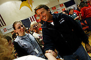 U.S. Democratic presidential candidate John Edwards speaks to potential voters during a campaign stop in Exira, Iowa, October 16, 2007.