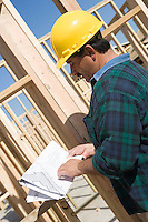 Construction Worker reading blueprint
