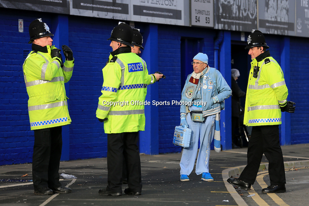 10th January 2015 - Barclays Premier League - Everton v Manchester City - A Man City fan stands amongst a group of police officers outside the ground - Photo: Simon Stacpoole / Offside.