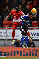 Orient's Kevin Lisbie and Swindon's Alan Navarro compete for the ball - Photo mandatory by-line: Mitchell Gunn/JMP - Tel: Mobile: 07966 386802 22/02/2014 - SPORT - FOOTBALL - Brisbane Road - Leyton - Leyton Orient V Swindon Town - League One