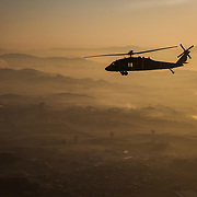 UH-60A/L Blackhawk with C Company, 3-2 GSAB flies over South Korea at dawn during Key Resolve '16