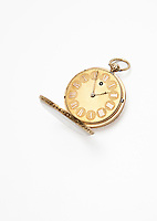 Golden pocket watch over white background