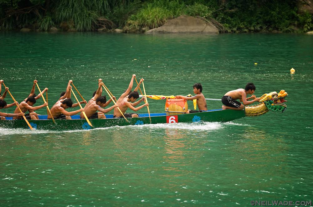 A dragon boat races in Xindian, Taiwan.