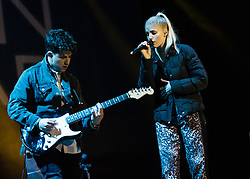 © Licensed to London News Pictures. 06/09/2014. Isle of Wight, UK. London Grammar performing live at Bestival 2014 Day 3 Saturday.  In this picture Dan Rothman (left), Hannah Reid (right).  London Grammar are a British electronic pop trio formed by Hannah Reid (vocals), Dan Rothman (guitar) and Dominic 'Dot' Major (keyboard/drums).  This weekend's headliners include Chic featuring Nile Rodgers, Foals and Outcast.   Bestival is a four-day music festival held at the Robin Hill country park on the Isle of Wight, England. It has been held annually in late summer since 2004.    Photo credit : Richard Isaac/LNP