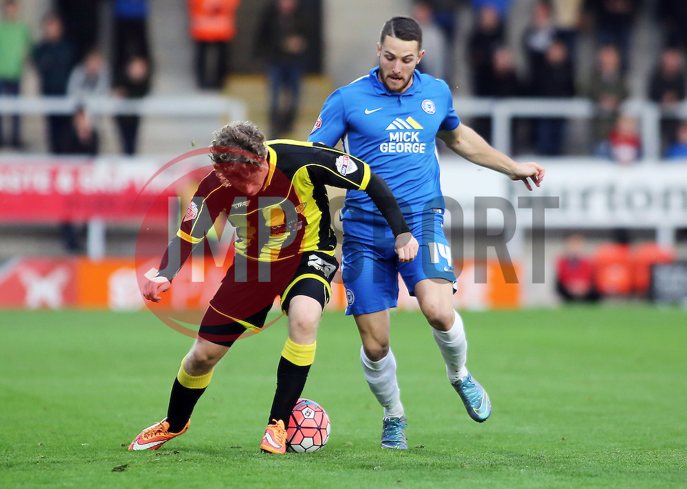 Conor Washington of Peterborough United in action with Matt Palmer of Burton Albion - Mandatory byline: Joe Dent/JMP - 07966 386802 - 07/11/2015 - FOOTBALL - Pirelli Stadium - Burton, England - Burton Albion v Peterborough United - FA Cup = First Round