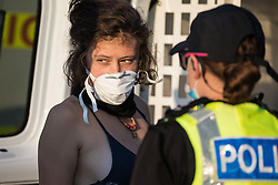 West Hyde, UK. 14th September, 2020. Hertfordshire Police arrest an environmental activist from HS2 Rebellion who, together with another activist, had used a lock-on arm tube to block a gate to the South Portal site for the HS2 high-speed rail link. Anti-HS2 activists blocked two gates to the same works site for the controversial £106bn rail link, one remaining closed for over six hours and another for over twelve hours.