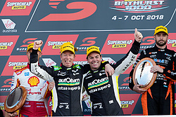October 8, 2018 - Bathurst, NSW, U.S. - BATHURST, NSW - OCTOBER 07: Race winners Craig Lowndes / Steven Richards in the Autobarn Lowndes Racing Holden Commodore celebrate on the podium at the Supercheap Auto Bathurst 1000 V8 Supercar Race at Mount Panorama Circuit in Bathurst, Australia on October 07, 2018 (Photo by Speed Media/Icon Sportswire) (Credit Image: © Speed Media/Icon SMI via ZUMA Press)