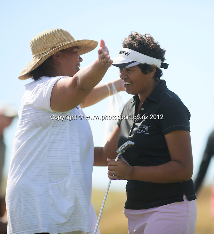 Chantelle Cassidy is congratulated by her mum on final day of the New Zealand stroke play championship, Paraparaumu Beach Golf Club, New Zealand. Sunday, 24 March, 2013. Photo: John Cowpland / photosport.co.nz