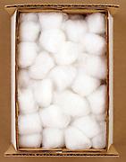 A carton box of cotton balls