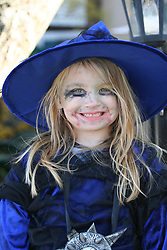 Little girl dressed as witch