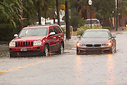 Cars stuck and abandoned in floodwater along Calhoun Street in the historic district as Hurricane Joaquin brings heavy rain, flooding and strong winds as it passes offshore October 3, 2015 in Charleston, South Carolina.
