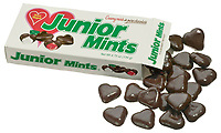 junior mints dark chocolate hearts photographed on a white background