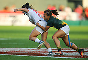 DUBAI, UNITED ARAB EMIRATES - Thursdays 30 November 2017, Mathrin Simmers of South Africa tackles Saskia Morgan of the USA during HSBC Emirates Airline Dubai Rugby Sevens match between South Africa and the USA at The Sevens Stadium in Dubai.<br /> Photo by Roger Sedres/ImageSA