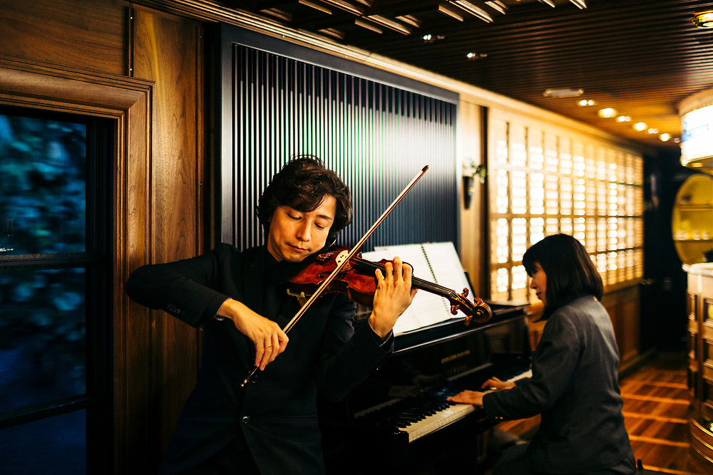 Musicians play classic and modern tunes in the dining car on the Seven Stars Kyushu luxury train in Japan.