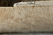 Epigraph on the monumental marble tomb, 69 AD, at the Porta Stabia or Stabian Gate, discovered 2017, in the Parco Archeologico di Pompei, or Archaeological Park of Pompeii, Campania, Italy. The tomb is that of a magistrate who is thought to have died during a fight at a gladiator contest. The detailed 4m long epigraph describes his life, achievements and death. The site was excavated as part of the Great Pompeii Project in the San Paolino area near Porta Stabia, one of the access points to the ancient city. A new phase of official excavations has been taking place here since 2017 in an attempt to stop looters from digging tunnels and removing artefacts for sale. Pompeii was a Roman city which was buried in ash after the eruption of Vesuvius in 79 AD. The site is listed as a UNESCO World Heritage Site. Picture by Manuel Cohen