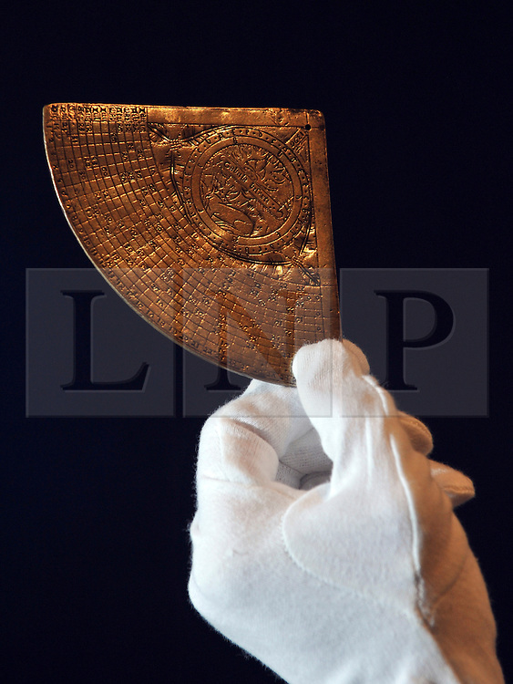 © Licensed to London News Pictures. 09/12/2011, London, UK. A rare 14th century time-telling instrument, marked with badge of Richard II is to auction at Bonhams on December 13th. One of the only known 14th century instruments, an exceedingly rare equal hour horary quadrant marked with the badge of King Richard II1.  The item was discovered in a shed in Queensland Australia. It is expected to fetch 150,000 - 200,000 GBP. Photo credit : Stephen Simpson/LNP