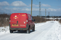 © London News Pictures. 12/03.2013. The village of Yelsted on the North Downs, Kent.Royal Mail delivery van on a snowiy country lane. Overnight snow leaves snowdrifts up to 3 feet deep on the North Downs in Kent. Picture credit should read Manu Palomeque/LNP