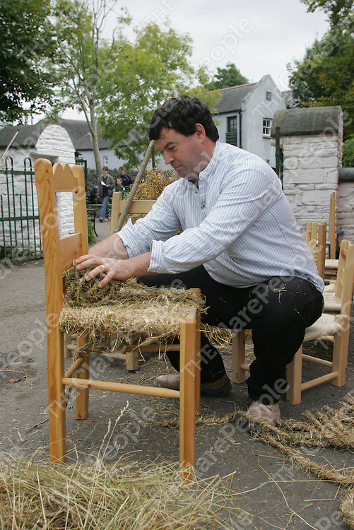 Pat Broderick of Inisross Wood Craft making a Chair  At the Harvest Fair held in Bunratty Folk Park .<br />