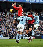Fotball<br /> England<br /> Foto: Fotosports/Digitalsport<br /> NORWAY ONLY<br /> <br /> Cristiano Ronaldo Handles the ball after being challenged by Team Mate Dimitar Berbatov and Manchester City's Pablo Zabeleta and Micah Richards and is sent off by Referee Howard Webb<br /> Manchester United 2008/09<br /> Manchester City V Manchester United (0-1) 30/11/08<br /> The Premier League