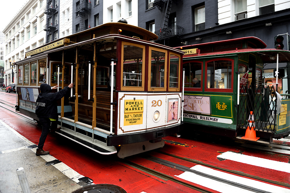 A cable car on a rainy winter day in San Francisco, California on November 16'th, 2017. San Francisco's Municipal Railway has assembled one of the most diverse collections of vintage streetcars, trolleys, and trams in transit service. Photo by Gili Yaari