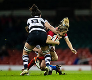 Elinor Snowsill of Wales is tackled by Charmaine McMenamin of Barbarians<br /> <br /> Photographer Simon King/Replay Images<br /> <br /> Friendly - Wales v Barbarians - Saturday 30th November 2019 - Principality Stadium - Cardiff<br /> <br /> World Copyright © Replay Images . All rights reserved. info@replayimages.co.uk - http://replayimages.co.uk