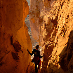 Nicholle Kovach hikes a canyon at Chaco Canyon National Park.