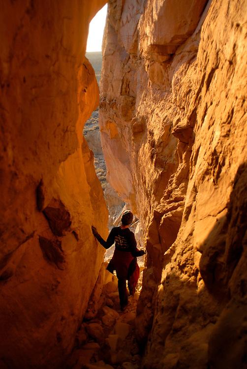Nicholle Kovach hikes a canyon at Chaco Canyon National Park.